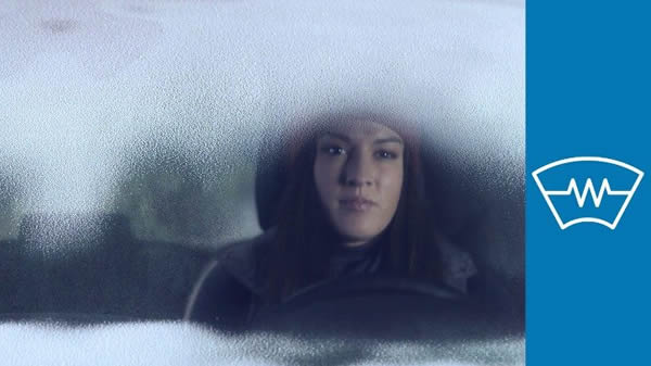 FordPass Connect - woman sitting in a car with frosted up window